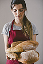 Woman holding different home made breads - EBSF001396