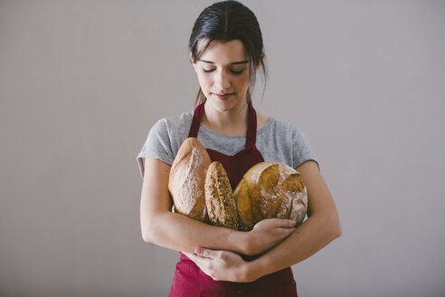 Woman with hand made bread - EBSF001399