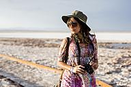 Chile, San Pedro de Atacama, woman with camera in the desert - MAUF000611