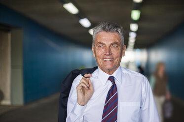 Portrait of confident senior businessman in tunnel - DIGF000553