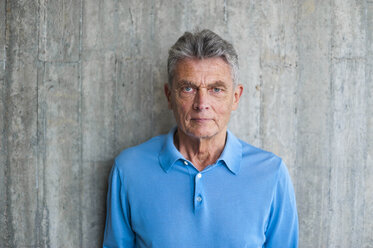 Portrait of senior man at concrete wall - DIGF000556