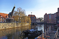 Germany, Lower Saxony, Luneburg, old harbour crane and Ilmenau river, Luener Muehle - KLR000323