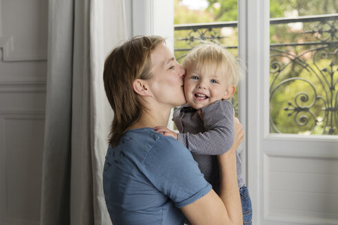 Portrait of smiling toddler kissing by his mother - LITF000315
