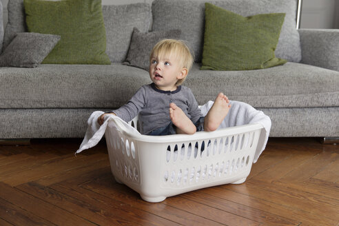 Toddler sitting in a laundry basket - LITF000333
