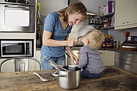 Mother and son playing together with kitchen utensils - LITF000351