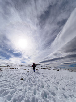Spain, Sierra de Gredos, man hiking in snow - LAF001632
