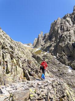 Spain, Sierra de Gredos, man hiking in mountains - LAF001647