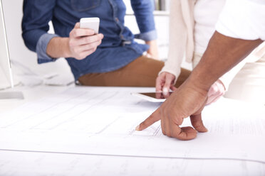 Hand pointing on construction plan - MFRF000674