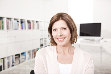 Portrait of smiling woman in the office - MFRF000701