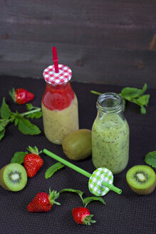 Two glass bottles of different smoothies - YFF000543