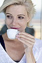 Mature woman with a cup of coffee - ONBF000002