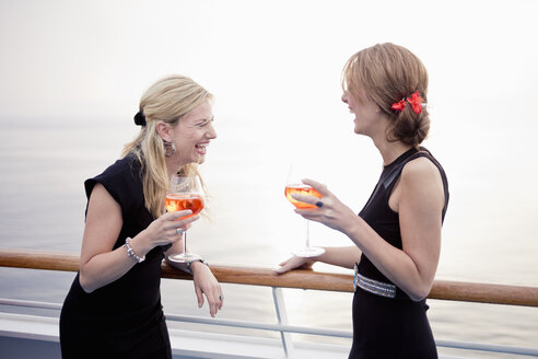 Two laughing women with aperitive  stending on deck of a cruise liner - ONBF000027