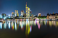 Germany, Frankfurt, lighted skyline with Main River in the foreground - TAMF000490