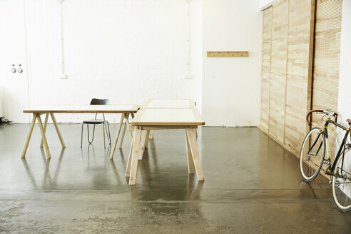 Desks and racing cycle in a studio - TSFF000061
