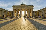 Germany, Berlin, Brandenburger Tor and Pariser Platz at backlight - TAM000503