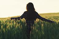 Woman in a field - OPF000116