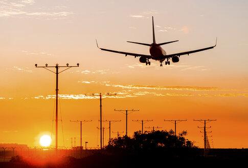 Jet landing at sunset - JLRF000036
