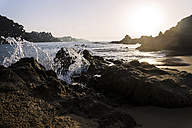 Spain, Costa Brava, rocky beach at sunrise - PUF000513