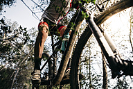Close-up of mountain biker on the move - JRFF000723