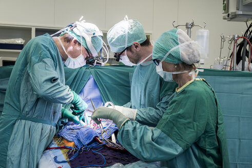 Heart surgeons and operating room nurse during a heart valve operation - MWEF000055