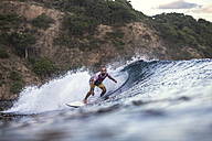 Indonesia, Sumbawa island, Surfer - KNTF000289