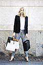 Portrait of serious looking woman with many shopping bags - GDF001001