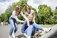 Three young woman having fun together - FMKF002707