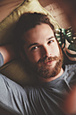 Portrait of bearded young man taking a selfie at home - RTBF000222