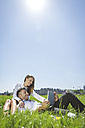 Happy business couple with digital tablet in meadow - MADF000913