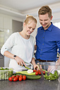 Couple in kitchen preparing a salad - SHKF000603