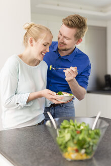 Happy couple in kitchen with salad - SHKF000606
