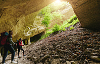 Serbia, Rakovac, young couple hiking in cave, abandoned quarry - ZEDF000171