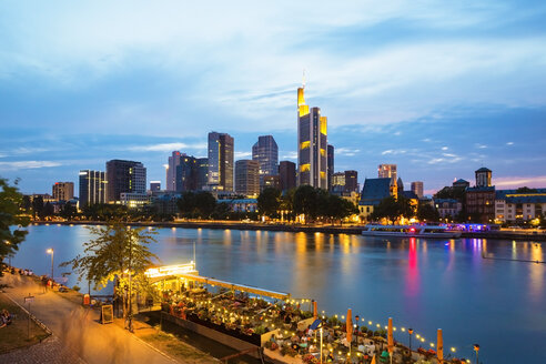 Germany, Hesse, Frankfurt, Financial district and Main river in the evening - TAMF000511