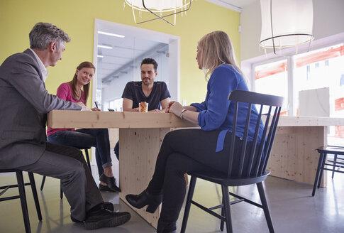 Business people having a meeting in board room - RHF001515