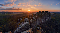 Germany, Saxony, Elbe Sandstone Mountains, rocks of the Falkenstein and Schrammsteine at sunset - RUEF001708