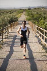 Athlete running in rural landscape - JASF000770