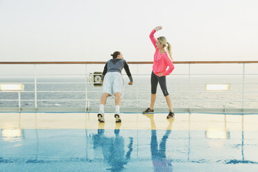 Couple doing light workout on a shipdeck, cruise ship, Mediterranean Sea - ONBF000046