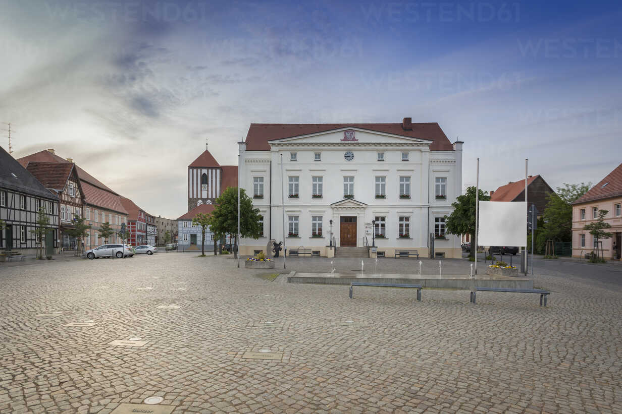 Germany, Brandenburg, Wusterhausen: Townhall and market square with art installation and small fountain - NKF000463 - Stefan Kunert/Westend61