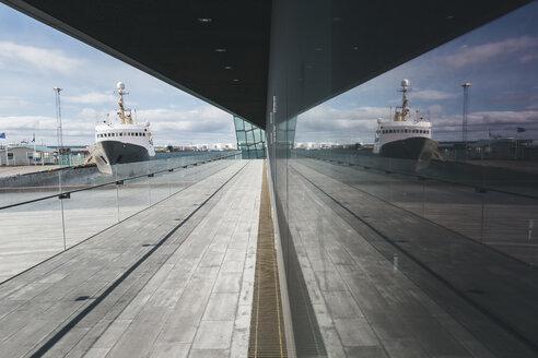Iceland, Reykjavik, reflection in facade of Harpa concert hall - ASCF000611