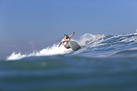 Indonesia, Bali, Surfer on wave - KNTF000315
