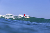 Indonesia, Bali, Surfer on wave - KNTF000321