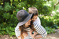 Playful mother and son outdoors - VABF000540