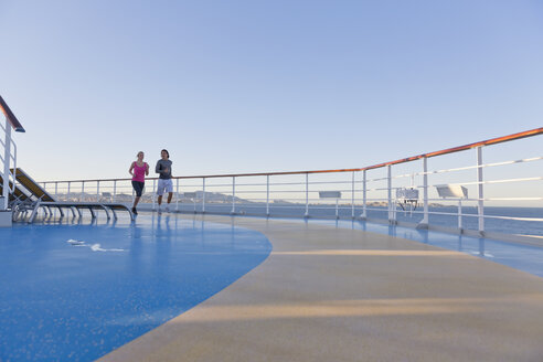 Young couple is jogging around the shipdeck of a cruise ship, Mediterranean Sea - ONBF000058