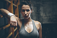 Female athlete on wall bars - MADF000960