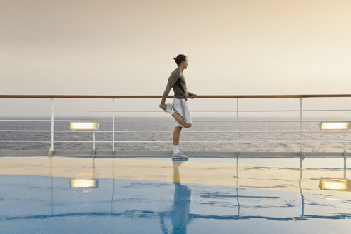 Young man doing exercises on a shipdeck, cruise ship, Mediteranean Sea - ONBF000063