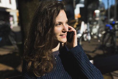 Portrait of smiling woman telephoning with smartphone - BOYF000395