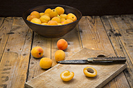 Sliced and whole apricots on wood - LVF004927