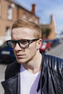 Portrait of strawberry blonde young man wearing black glasses - BOYF000415