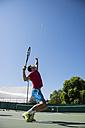 Tennis player serving a tennis ball during a tennis match - ABZF000649