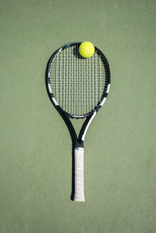Racket and ball on a tennis court - ABZF000658